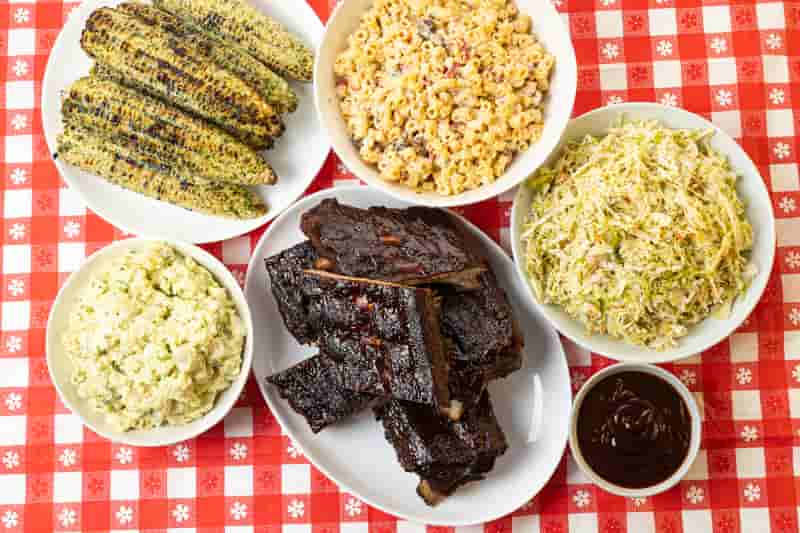 Summer Cookout Meal with BBQ ribs, roasted corn and potato salad