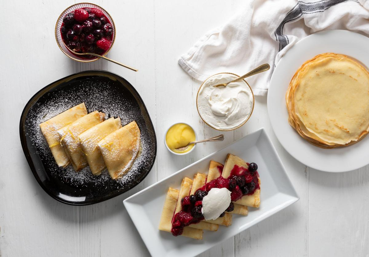 Breakfast Crepes with whipped creme fraiche, mixed berries and lemon curd
